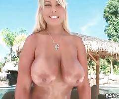 Attractive Bridgette B is playing with her huge oiled boobs.