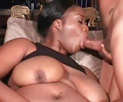 Delicious plump ebony babe is caressing herself on couch dreaming of cock.