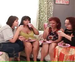 Four chubby mature lesbians play with whipped cream.