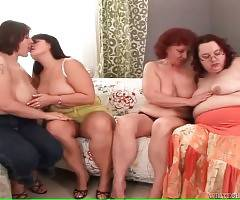 Four craving obese ladies are caressing each other.