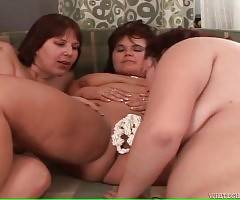 Chubby older sluts cover girlfriends` cunts with whipped cream and lick them.